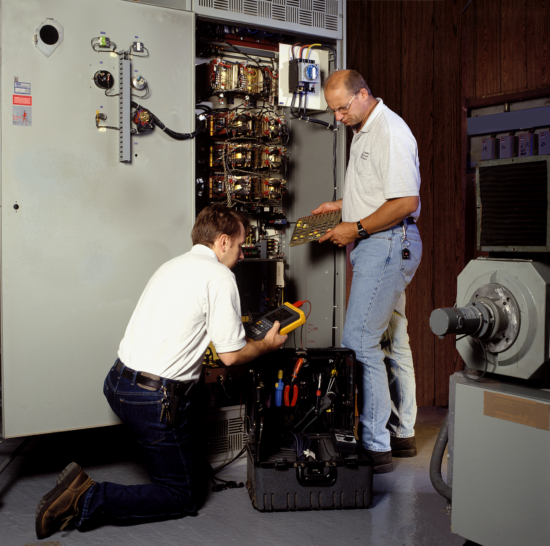 Employees servicing equipment